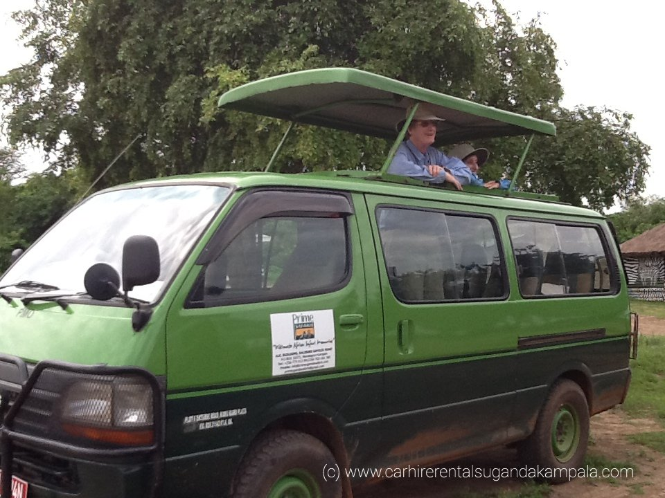 4x4 (9-seats) safari car for hire with a pop-up roof top.